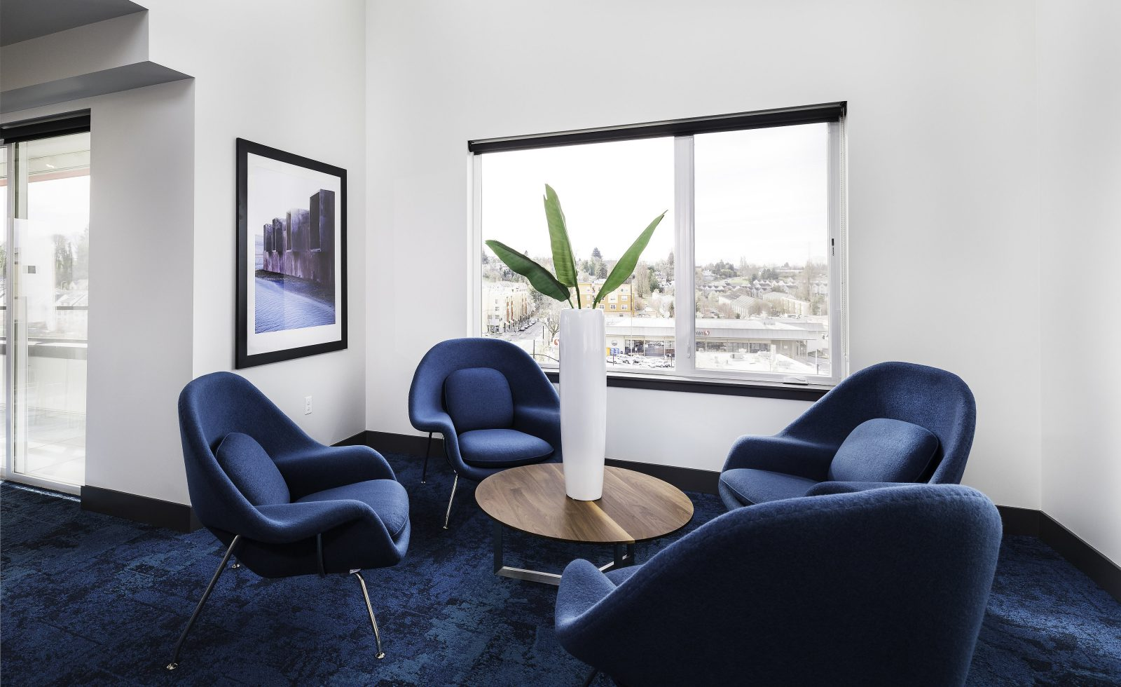 Sky Lounge seating area with a brown table and 4 blue chairs